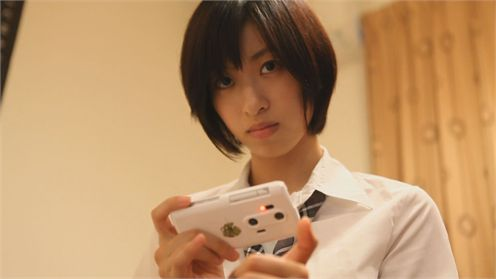 GFP Bunny's Thallium Girl with her trusty smartphone (Picture courtesy of The Japan Times)